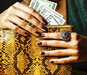 Pretty Fingers Of African American Woman Holding Money Close Up With Purse, Luxury Jewellery On Pyth poster