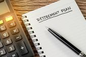 Retirement Plan Concept, Calculator With Empty Notepad With Pen And Handwriting Headline As Retireme poster