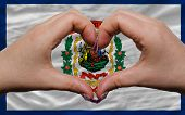 Over American State Flag Of West Virginia Showed Heart And Love Gesture Made By Hands