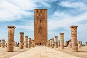 Tour Hassan Tower With Stone Columns In The Square - Hassan Tower Or Tour Hassan Is The Minaret Of A poster