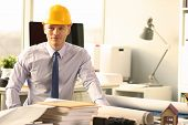 Confident Civil Engineer Working On House Sketch. Young Architect Sitting At Workplace. Man Wearing  poster