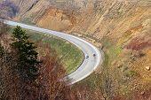 stock photo of sakhalin  - Mountain mouting pass Kholmskiy on island Sakhalin passenger car goes On road - JPG