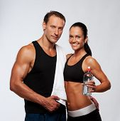 stock photo of drinking water  - Athletic man and woman after fitness exercise - JPG