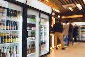 Background Blurred Defocused Beers Are Cooling In Fridge, Freezer Or Refrigerator Shelf. Defocused B poster