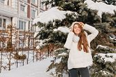 Charming Young Woman Chilling In Sunny Frozen Morning On Street Full With Snow. Joyful Smiling Girl  poster