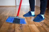 Young Woman, Wife In Blue Slippers Using Indoor Blue Broom For Hardwood Floor Cleaning. Spring Clean poster
