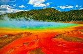 pic of microorganisms  - Beautiful cerulean geyser surrounded by colorful layers of bacteria against cloudy blue sky - JPG