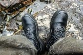 Black Mountain Boots In River. Footwear For Tourist, Hiking. Waterproof Boots. poster