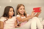 Kids Taking Selfie In Bedroom. Pajamas Party Concept. Girlish Leisure Happy Childhood. Girls Long Ha poster