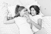 Sisters Happy Small Kids Relaxing In Bedroom. Friendship Of Small Girls. Leisure And Fun. Having Fun poster
