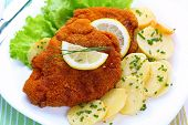 stock photo of fried chicken  - Wiener Schnitzel with potato salad - JPG