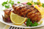 stock photo of poultry  - Grilled chicken breast with warm corn and potato salad - JPG