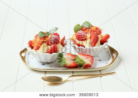 two cream dessert in the bowl, decorated with fresh fruit