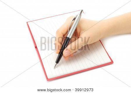 Writing woman hand on notepad