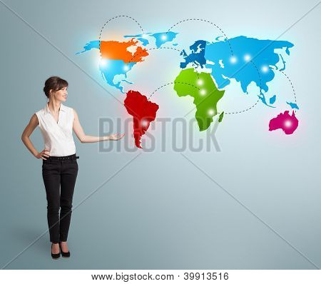 Beautiful young woman presenting colorful world map