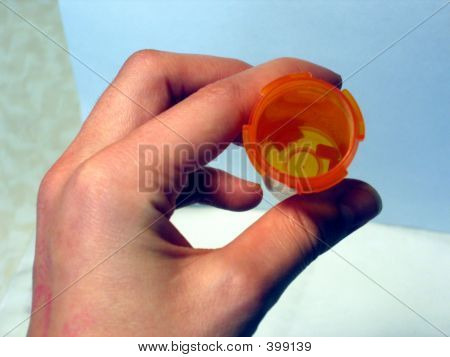 Holding A Pill Bottle