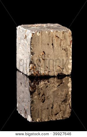 Unpolished block of pyrite mineral, an iron sulfide resembling gold. Often confused with gold and therefore also called Fool's Gold