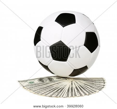 Soccer ball on heap of dollars isolated on a white background