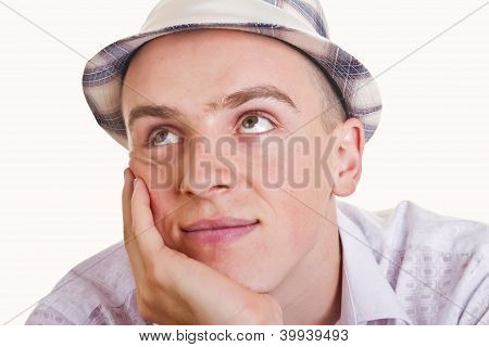 A young man in hat on a white background
