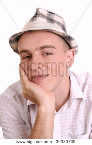 A young man inhat on a white background