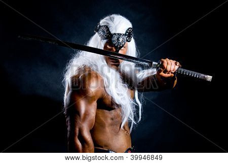 Portrait Of A Muscular Warrior With A Sword And A Long White Hair