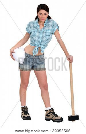 Attractive brunette posing with sledge-hammer