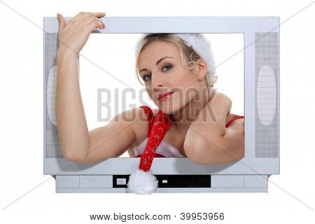 Woman protruding from a television screen