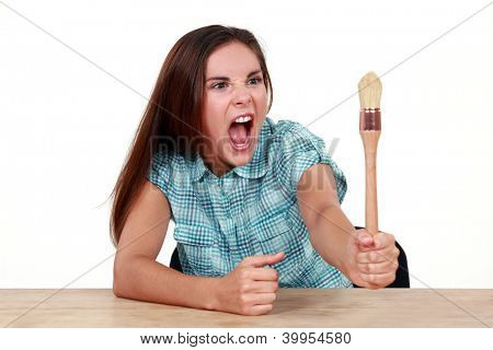 Woman arguing with a paintbrush