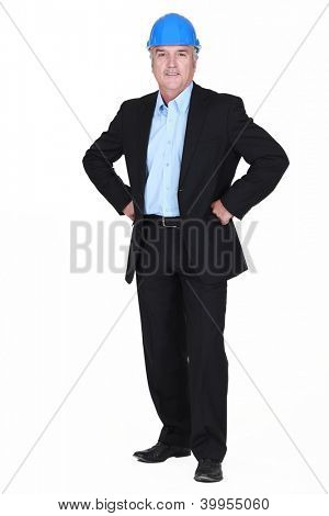 full-body picture of mature architect with arms akimbo
