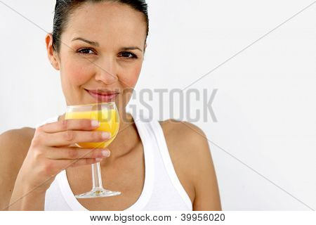 Woman having refreshing glass of orange juice