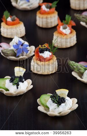 Assorted Mini Canapes Over Black