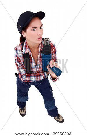 Naughty woman blowing on a screw gun
