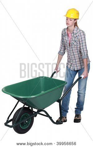 Woman pushing empty wheelbarrow