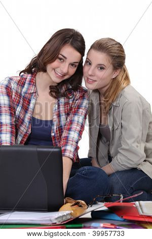 Girls sitting on the floor with computer