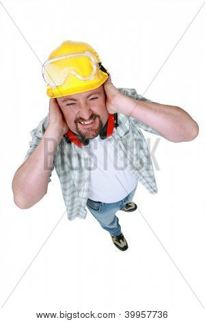 Landscape picture of worker covering his ears