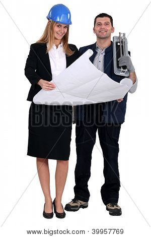 Tile cutter stood with female architect