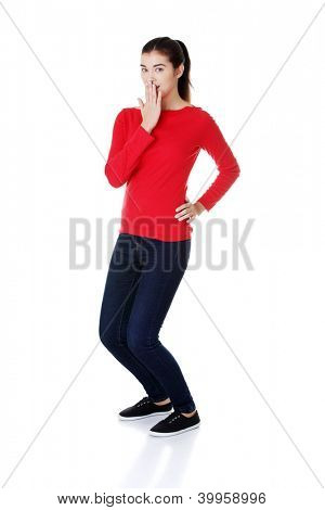 Shocked woman covering her mouth with hand, isolated on white