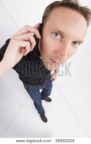 Mid adult man using cell phone