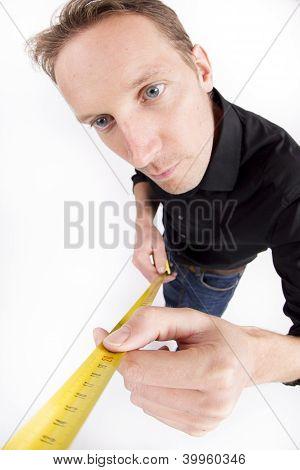 Mid adult man holding tape measure