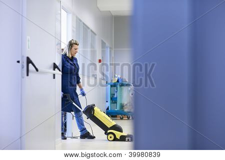 Women At Workplace, Professional Female Cleaner Washing Floor In Office