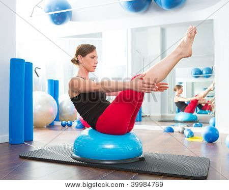 Bosu ball for fitness instructor woman in aerobics gym