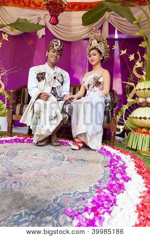 Couple enacting wedding scene in preparation for religious ceremony