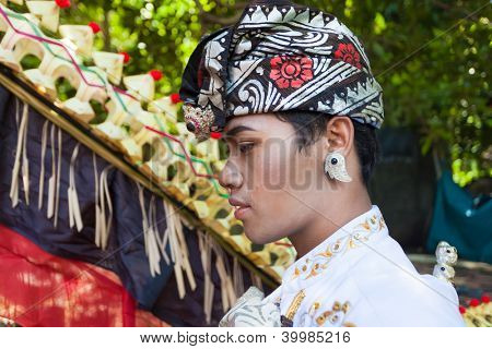 Man enacting wedding scene in preparation for religious ceremony