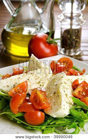 Caprese salad, italian appetizer with mozzarella and tomatoes
