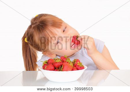 Beautiful Little Girl Eating Strawberries