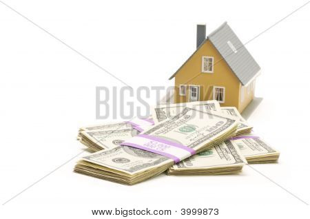 Home And Stacks Of Money Isolated