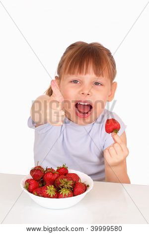 Happy Little Girl With A White Soup Plate With Tasty Strawberries