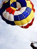foto of parasailing  - Man Parasailing - JPG