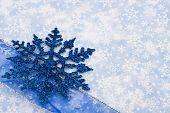 foto of happy holidays  - Blue snowflake and ribbon on snowflake background holiday border - JPG