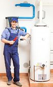 picture of pipefitter  - Smiling technician repairing an hot - JPG